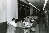 Students at study tables in the reference section of Nyselius Library