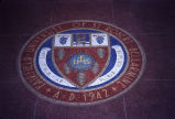 Mosaic of the official seal of Fairfield University in the foyer of Alumni Hall