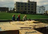 Fairfield University students constructing Cardboard City on campus