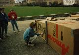 Student spray-painting at Cardboard City 1990