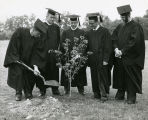 Graduates of the Class of 1958 plant the class tree