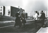 Rev. William C. McInnes, S.J., President of Fairfield University, and others crossing street